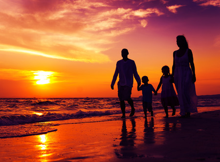 family vacations: Family walking on the beach happiness Concept