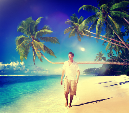 man relaxing beach holiday vacation leisure concept stock photo