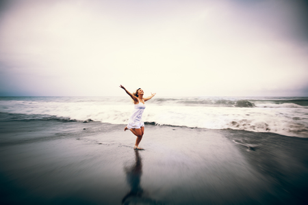 freedom nature: Young Woman Beach Relaxation Freedom Solitude Concept Stock Photo