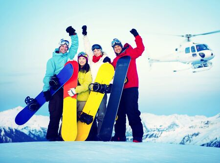 heli: Snowboarders Success Sport Friendship Snowboarding Concept Stock Photo