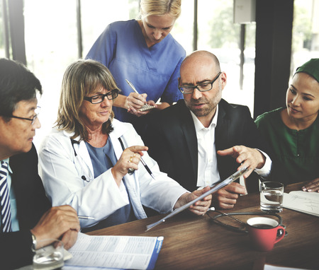 diverse women: Doctor Meeting Teamwork Diagnosis Healthcare Concept Stock Photo