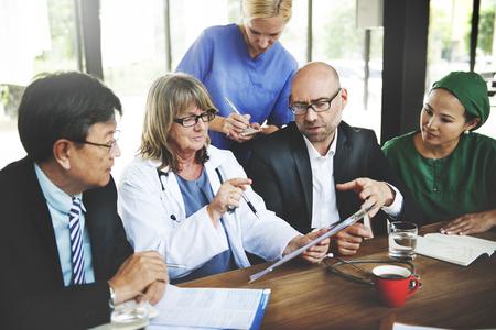 a diagnosis: Doctor Meeting Teamwork Diagnosis Healthcare Concept Stock Photo