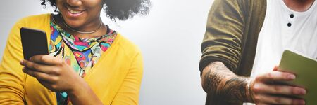 of african descent: African Woman Using Mobile Phone Social Media Concept