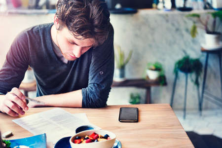 reading and writing: Man Reading Writing Research Thinkning Cafe Restaurant Concept