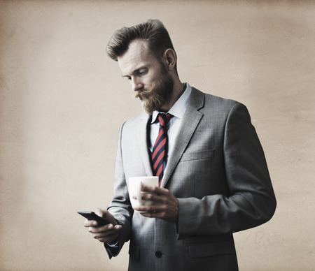 coffee breaks: Businessman Thinking Break Using Smartphone Concept