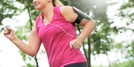 sportwoman: Exercise Athlete Playlist Gadget Smartphone Sporty Concept