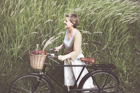 classic woman: Woman Senior Bicycle Carefree Freshness Peaceful Concept