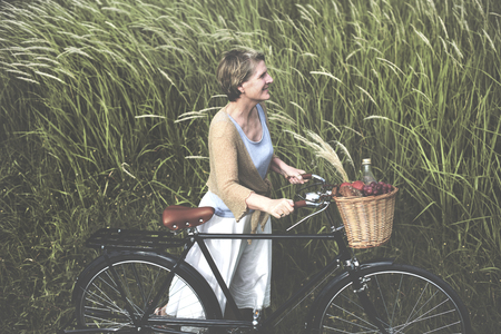 the carefree: Woman Senior Bicycle Carefree Freshness Peaceful Concept