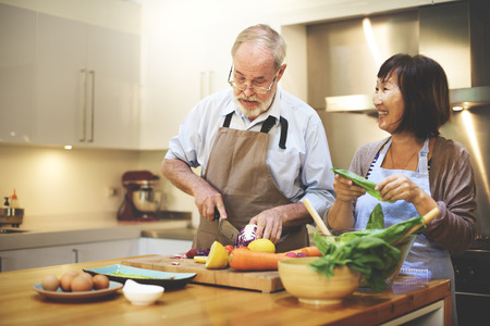 an elderly person: Cooking Couples Elders Kitchen Food Happiness Family Fresh Meal Home Concept Stock Photo