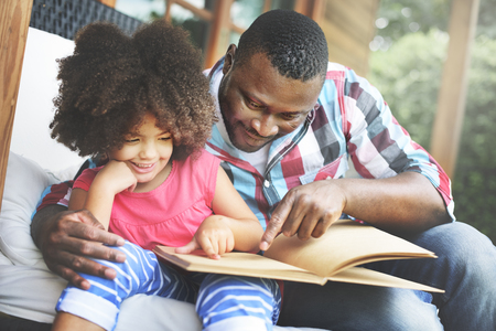 kid reading: Father Daugther Bonding Cozy Parenting Education Concept