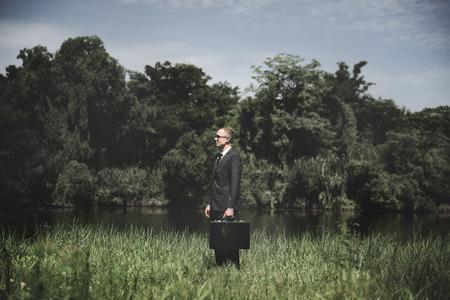 El hombre de negocios de planificación concepto verde Estrategia para la Conservación del Medio Ambiente Foto de archivo