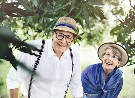 exploring: Mature Couple Exploring Together Outdoors Concept