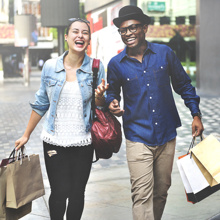 lifestyle shopping: Couple Shopping Outdoors Store Lifestyle Concept