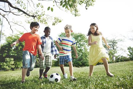 Kids Children Playing Football Fun Happiness Concept Foto de archivo