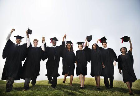 graduate student: Group Students Hands Raised Graduation Concept