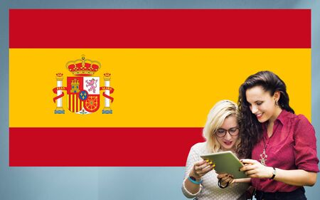 adult student: Spain National Flag Studying Women Students Concept