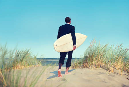 walking alone: Alone Businessman by the Beach with Surfboard Concept