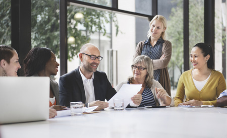 community work: Group of Business People Discussing Office Concept Stock Photo