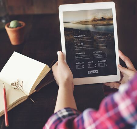 flight booking: Woman Holding Tablet Flight Booking Search Concept Stock Photo