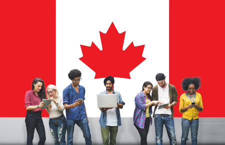 Canada National Flag Studying Diversity Students Concept Stock Photo