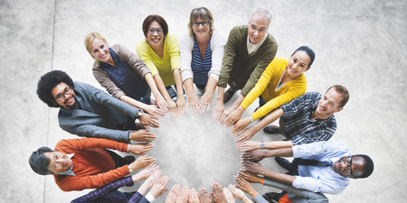 togetherness: Multi-Ethnic Diverse Group of People In Circle Concept Stock Photo