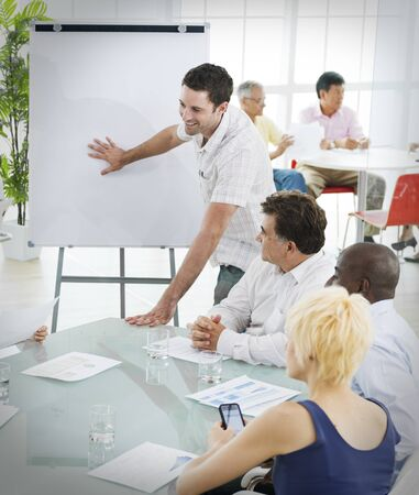 strategy meeting: Group of Business People in the Office Concept Stock Photo