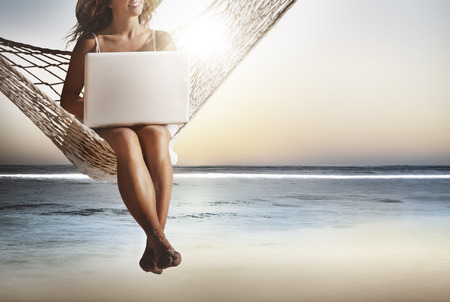 getting away from it all: Business Woman Women Internet Laptop Wireless Concept Stock Photo