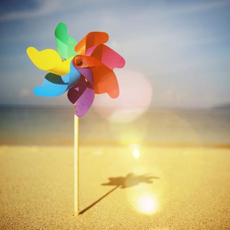 pinwheels: Pinwheels On The Beach Blowing Sunshine Concept