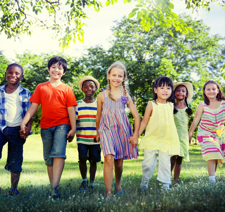 group of hands: Diverse Children Friendship Playing Outdoors Concept Stock Photo