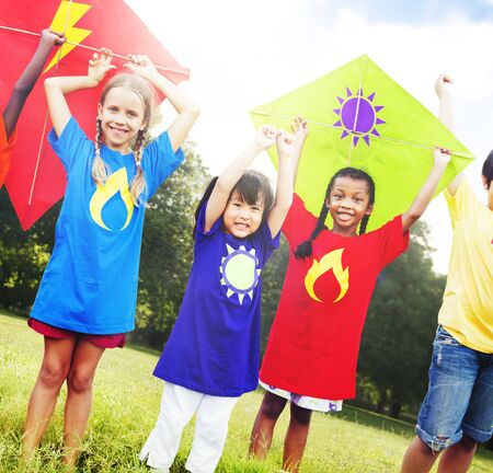 flying kites: Children Flying Kite Playful Friendship Concept Stock Photo