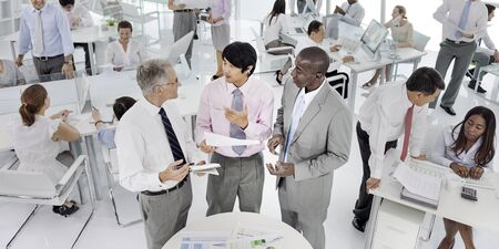 BUSY OFFICE: Business People Conversation Communication Talking Team Concept Stock Photo