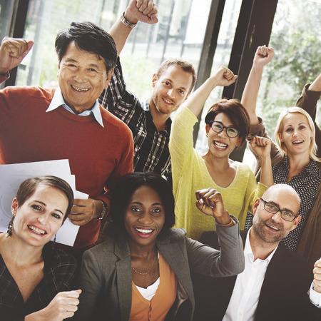 úspěšný: Obchodní tým dosažení úspěchu Arm Raised Concept Reklamní fotografie