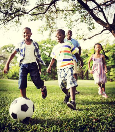 kids playing sports: African Family Happiness Holiday Vacation Activity Concept