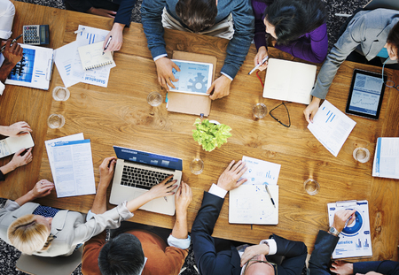 business technology: Group of Business People Working in the Office Concept Stock Photo