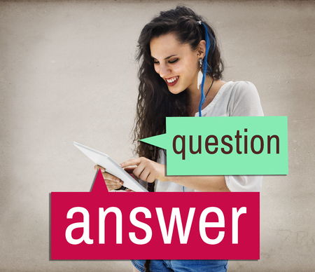 Woman using a digital tablet with question and answer concept Stock Photo