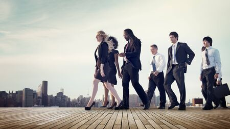 rushing hour: Business Team Walking Teamwork Cityscape Concept Stock Photo