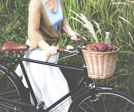 bicycling: Senior Woman Bicycling Windy Park Concept
