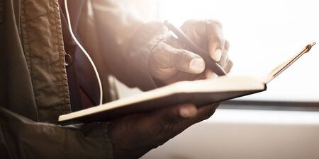 african man: Businessman Record Writing Brainstorming Travel Concept