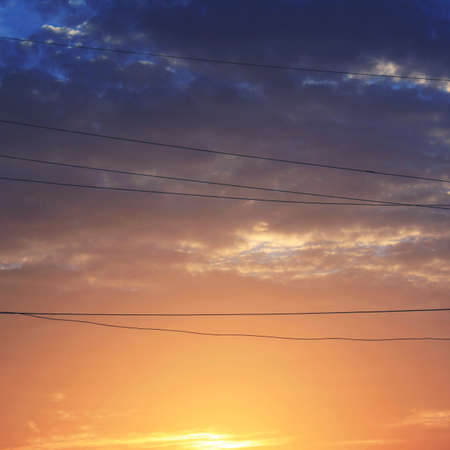 electric wire: Vibrant Twilight Dawn Energy Electric Wire Peace Concept Stock Photo