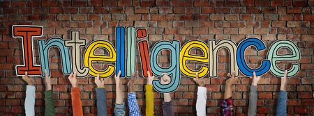 proficient: Group of Hands Holding Intelligence Word Concept