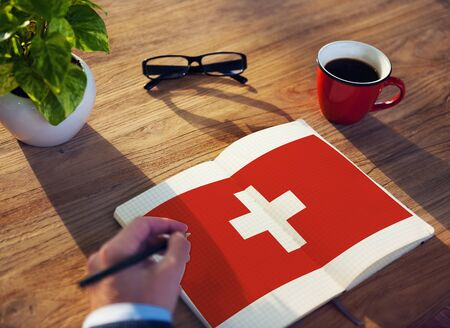 swiss culture: Switzerland National Flag Studying Reading Book Concept Stock Photo