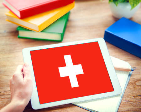 swiss culture: Browsing Network Internet Switzerland Flag Concept Stock Photo