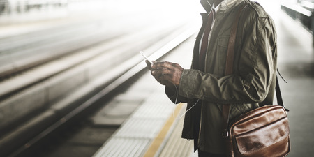 Man using his mobile phone while commuting to work