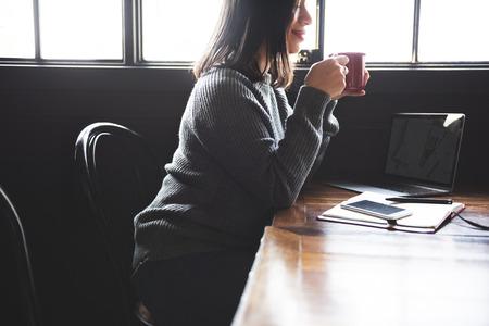 Woman in office taking a break