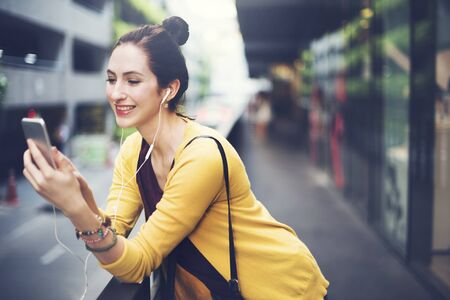 madam: Woman with Connection Digital Device Internet Concept Stock Photo