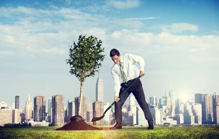 shoveling: Shoveling Business District Cityscape Growth Tree Concept Stock Photo