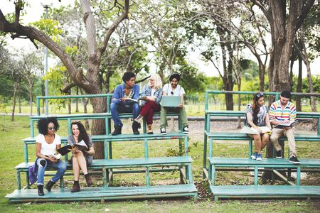 college campus: Group Students Studying Bleachers Together Concept