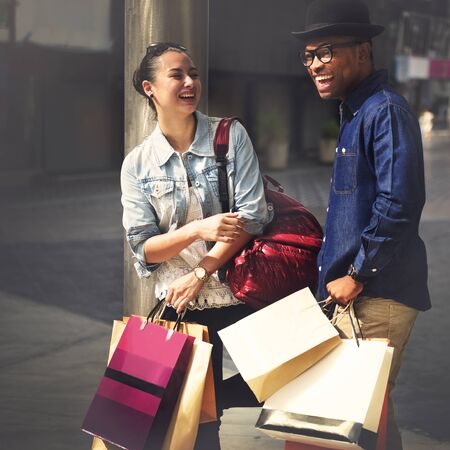 spending: Shopping Couple Capitalism Enjoying Romance Spending Concept Stock Photo