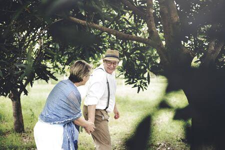 love park: Senior Adult Couple Love Romance Nature Park Concept Stock Photo