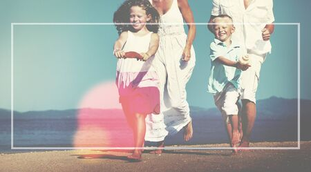 margin: Family Running Playful Vacation Beach Margin Concept Stock Photo